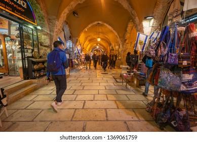 Jerusalem, Israel - 16 December, 2018: A tourist walking therough a market in the Jewish Quarter