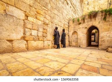 Jerusalem, Israel - 16 December, 2018: Two orthodox Jewish men praying at the little western wall