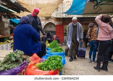 Jerusalem, Israel - 16 December, 2018: Ladies selling vegetables in the Muslim Quarter Market.