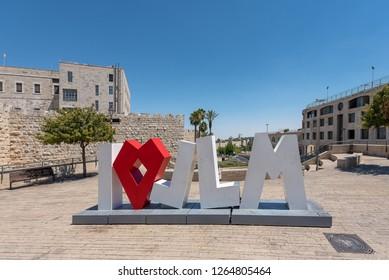 Jerusalem, Israel - 17 September 2018: the inscription 'I love Jerusalem', a sculpture decor in the street against the background of the old city of Jerusalem, Israel