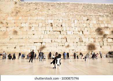 JERUSALEM, ISRAEL - 2018 FEBRUARY 20 : Jewish people praying at the Western Wailing Kotel Wall in the old city of Jerusalem