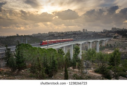Jerusalem, Israel - 2018-11-19: A train crossing a valley bridge on the outskirts of Jerusalem heading to Tel Aviv