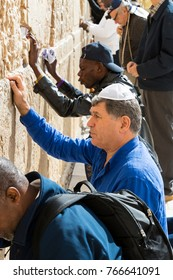JERUSALEM, ISRAEL - 22 NOVEMBER 2017: Pilgrims pray at the wall of the weeping of the holy place of the Jewish people and the center of worship of Christians around the world