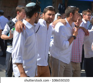 JERUSALEM ISRAEL 26 10 16: Jewish men celebrate Simchat Torah. Simchat Torah is a celebratory Jewish holiday marks the completion of the annual Torah reading cycle.