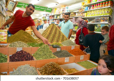 JERUSALEM, ISRAEL 26 10 16: Man sell spices in old town of Jerusalem. The Machane Yehuda Market, or shuk, is the largest market in Jerusalem with over 250 vendors