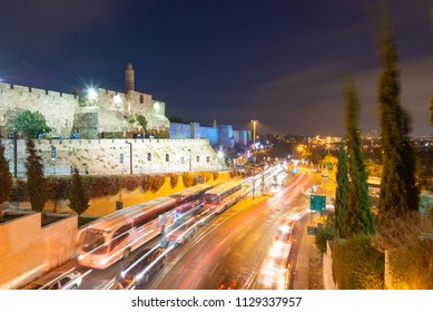 Jerusalem, Israel - 28 July, 2018: Traffic passing by the Tower of David during a sound and light show on the outer walls of the Old City.