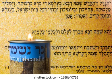 Jerusalem, ISRAEL / 31 MARCH 2020: A memorial (Yizkor) candle is lit in front of the Jewish prayer for the dead (Kaddish).