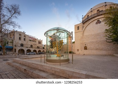 Jerusalem, Israel - 9 November, 2018: A replica of the menorah in front of the Hurva Synagogue in the old city Jewish Quarter