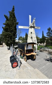 Jerusalem, Israel - April 11, 2019: Montefiore windmill in Jerusalem. It is famous municipal museum and public domain in Israel, on foreground one can see a vintage stylish coffee shop for tourists