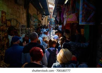 JERUSALEM, ISRAEL - April 16, 2017: People are promenading through Old City Market (Arab Souq).