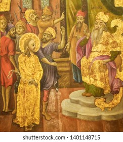 Jerusalem, Israel - April 17, 2019: Greek Orthodox Fresco in the Church of the Holy Sepulchre in Jerusalem, depicting Jesus about to be struck in front of former High Priest Annas, as in John 18:22
