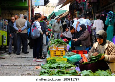 JERUSALEM, ISRAEL - APRIL 17 - At the Muslim Quarter in the old city, Palestine woman sell vegetables in the middle of the street