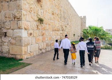 JERUSALEM, ISRAEL - APRIL 2017:  the Jewish family goes to prayer, the old Jerusalem.