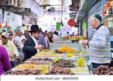 JERUSALEM, ISRAEL - APRIL 2017:  Market sketch, Israeli trade, seller and buyer in Israely Market Mahane Yehuda, Jerusalem