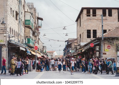 JERUSALEM, ISRAEL - APRIL 2017: People buy foodstuff at the Jerusalem Mahane Yehuda local market
