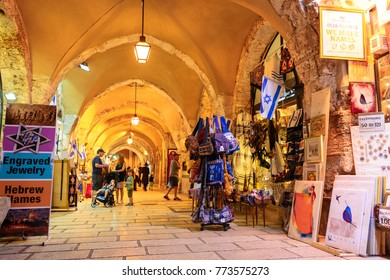 JERUSALEM, ISRAEL - APRIL 2017: Tourists walk trough the market in the old city of Jerusalem