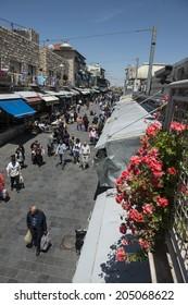 Jerusalem, israel - April 24, 2013: people passing by in 'machane yehuda' market, one of israel's busiest markets