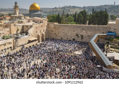 Jerusalem, Israel - April 25, 2016: The Western Wall filled with Jewish worshippers on Passover in order to receive the kohanic blessing.