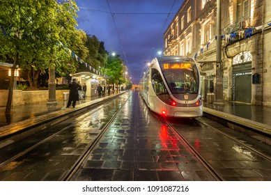 Jerusalem, Israel - April 26, 2018: The light train parked at the City Hall station on a stormy evening.