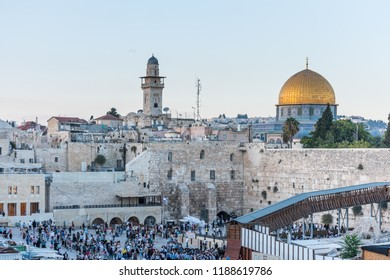 Jerusalem, Israel, Aug 19th, 2018: Lots of tourist at praying at the western wall and Golden Dome of the Rock under sunset, an Islamic shrine located on the Temple Mount in the Old City of Jerusalem.