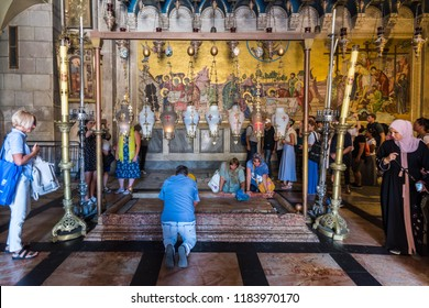Jerusalem, Israel, August 20th, 2018: Tourists and pilgrims are playing Stone of Anointing, the spot where Jesus' body was prepared for burial by Joseph of Arimathea, in Church of the Holy Sepulcher