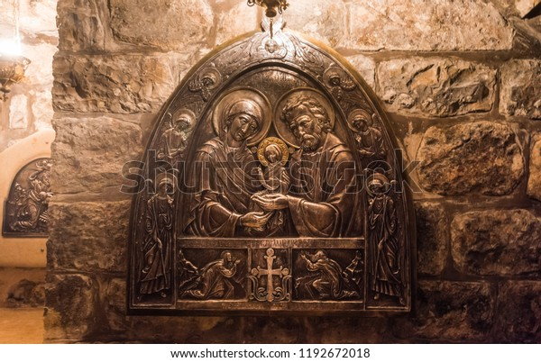 Jerusalem, Israel, August 20th, 2018:  Bas-reliefs of Baby Jesus and parents Birth place of Virgin Mary under the Church of St Anne in Jerusalem old town, Israel