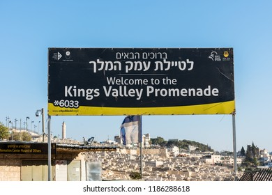 Jerusalem, Israel, August 20th, 2018:Signpost of King's Valley Promenade at the Kidron Valley or King's Valley,on the eastern side of the Old City of Jerusalem, Israel with background of Jewish tombs