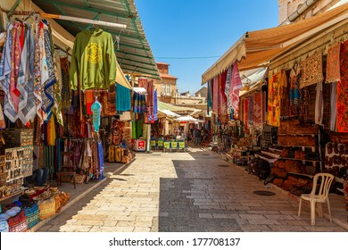 JERUSALEM, ISRAEL - AUGUST 21, 2013: Bazaar in Old City offers middle east traditional products and souvenirs. It is very popular with locals, tourists and pilgrims visiting Jerusalem, Israel.