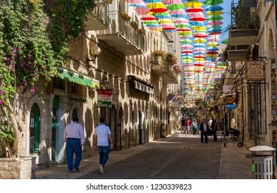Jerusalem, Israel, August 5th. 2016 - Multicolored umbrellas above the street Yoel Moshe Salomon in Jerusalem, district Nachalat Shiva.