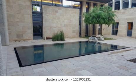 Jerusalem / Israel - August 7 2017: Knesset (national legislature of Israel), inner garden with little pool.