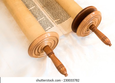 JERUSALEM, ISRAEL, CIRCA 2014:. The Hebrew handwritten Torah, on a synagogue alter, illustrating Jewish holidays, during fests. Half open