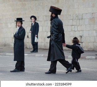 JERUSALEM, ISRAEL - CIRCA MAY, 2013 - Four of Jews walking and standing in the street of Jerusalem.