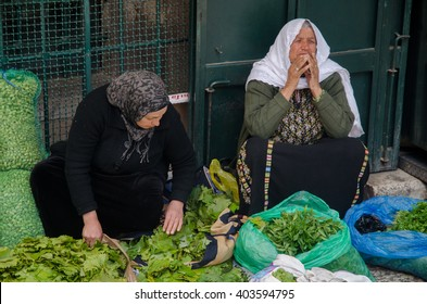 JERUSALEM, ISRAEL - CIRCA MAY, 2013 -  At the Muslim Quarter in the old city, Palestine woman sell vegetables in the middle of the street