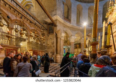 Jerusalem, Israel - Dec 01, 2018: Greek Pope directs people in line to enter the edicula in the Holy Sepulcher in Jerusalem
