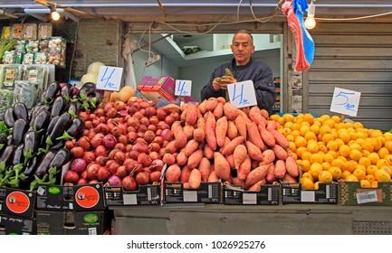 Jerusalem, Israel - December 1, 2017: man is selling fruits and vegetables at Machane Yehuda Market in Jerusalem, Israel