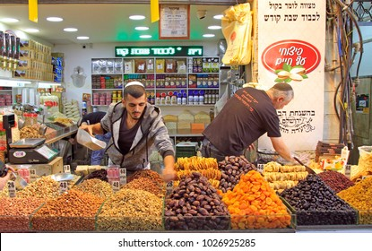 Jerusalem, Israel - December 1, 2017: men are selling dried fruits and nuts at Machane Yehuda Market in Jerusalem, Israel