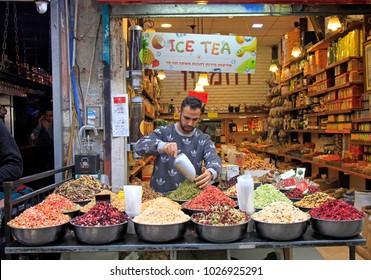 Jerusalem, Israel - December 1, 2017: man is selling tea at Machane Yehuda Market in Jerusalem, Israel