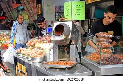 Jerusalem, Israel - December 1, 2017: man is selling sweets at Machane Yehuda Market in Jerusalem, Israel