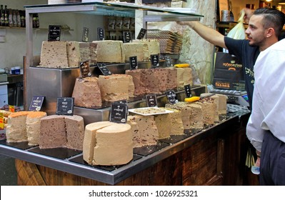 Jerusalem, Israel - December 1, 2017: man is selling halva at Machane Yehuda Market in Jerusalem, Israel