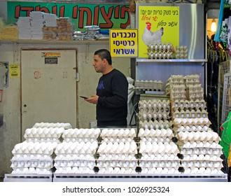 Jerusalem, Israel - December 1, 2017: man is selling eggs at Machane Yehuda Market in Jerusalem, Israel