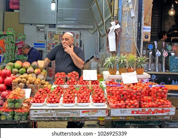 Jerusalem, Israel - December 1, 2017: man is selling at Machane Yehuda Market in Jerusalem, Israel