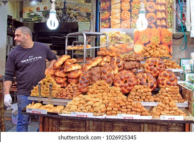 Jerusalem, Israel - December 1, 2017: man is selling pastries at Machane Yehuda Market in Jerusalem, Israel