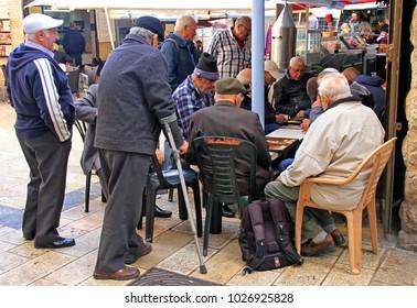 Jerusalem, Israel - December 1, 2017: men are playing backgammon at Machane Yehuda Market in Jerusalem, Israel