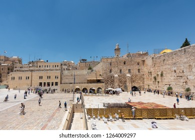Jerusalem, Israel - December 15th, 2018.  Jewish orthodox believers reading the Torah and praying facing the Western Wall, also known as Wailing Wall in Old City in Jerusalem, Israel.