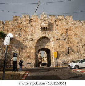 """Jerusalem, Israel - December 17th, 2020: The """"Lions gate"""" in the walls of ancient Jerusalem, on an overcast day."""