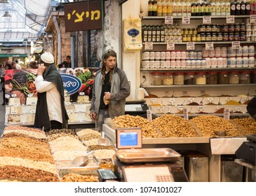 Jerusalem, Israel - December 18 2017: People are shopping in Mahane Yehuda Market, a local bazaar in the city.