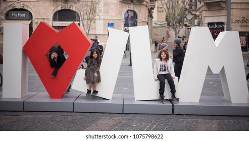 "Jerusalem, Israel - December 18 2017: Children are playing with the sign of ""I Love Jerusalem"" in the downtown triangle area."