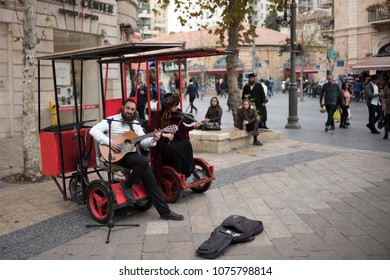 Jerusalem, Israel - December 18 2017: The street performers are busking  in the downtown triangle area on Ben Yehuda Street.