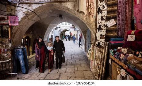 Jerusalem, Israel - December 18 2017: People walking in the narrow street  of Old City Jerusalem.