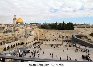 JERUSALEM, ISRAEL - DECEMBER 19: Jewish worshipers pray at the Wailing Wall an important jewish religious site  on December 19, 2012  in Jerusalem, Israel